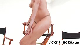 Victoria White plays with...