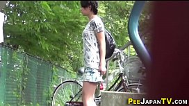 Asian teen pees outdoors