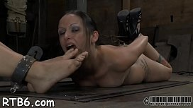 Alluring slaves are made to strip inside a diminutive cage