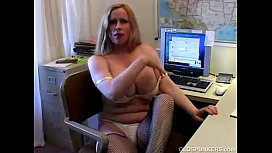 Busty cougar in fishnet...