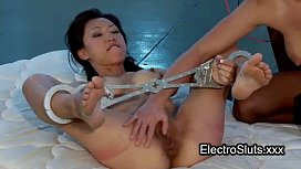 Shackled wired Asian ass...