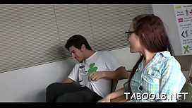 Enchanting brunette playgirl gives a spicy footjob to lucky dude