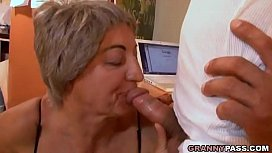 Busty Granny Seduces Young...