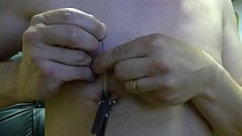 needle in nipple with clothe pin sex image