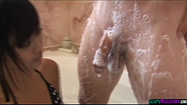 Young asian masseuse strokes clients dick