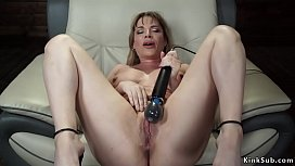 Busty Milf fucks machine in armchair