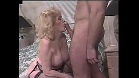 Experienced playful blonde hottie Kitty Foxx with big knockers invites younger fellow to have a good time