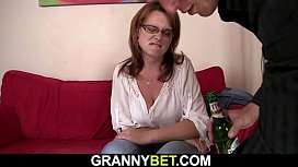 Busty mature woman rides his cock