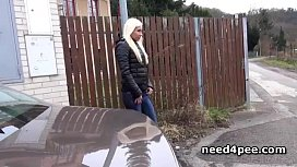 Tanned blonde pisses standing...
