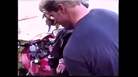 Muscle biker doggystyles horny girlfriend in leather suit on his motorcycle