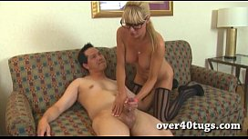 Hot milf with glasses gives a handjob