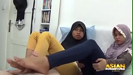 Two asian muslim babes jerking and begging for cum