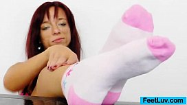 Redhead gives stirring footjobs...