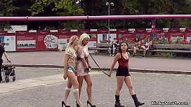 Two blondes pissed outdoor by mistress