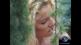 Curly haired blonde Jaqueline Stone giving a wet blowjob outdoors sex image