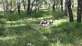 Outdoors, the voyeur spies on how masturbates milf in early pregnancy. Fetish on the meadow.
