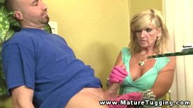 Busty mature tugging on...