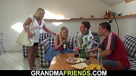 Very old blonde granny swallows two huge dicks