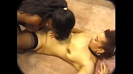 Three excellent ebony sluts are licking pussies and playing bright yellow toy