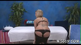 Steaming playgirl gets her pink pussy drilled on a massage table