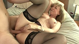 MILF slag Nina Hartley loves to suck big cock before getting on top to ride it hard