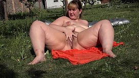 Vaginal fisting and gaping hole. Beautiful BBW with hairy pussy loves fetish masturbation in the garden outdoors.