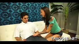 Enchanting brunette babe gives a spicy footjob to lucky lad