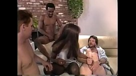 Busty well graced coloured woman takes off her silver dress and gets her holes screwed by five cocks