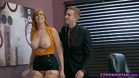 Busty office chick working...