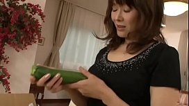 Japanese mother masturbating with a big cucumber