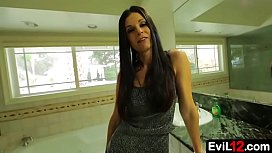 Leggy stepmom makes eye contact with the camera in a blowjob