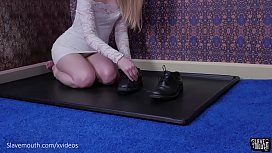 Beautiful blond gets her tongue painfully tied with shoelaces and worships balls