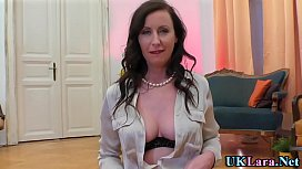 British milf brunette in stockings and heels