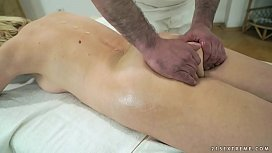 Older woman enjoys massage...