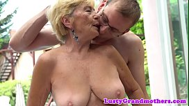 Busty grandma banged from...