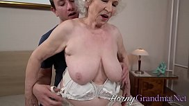 Busty old lady blows massive cock