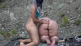 Lesbian with juicy booty sat on the face of a girlfriend for a pleasant cunnilingus. Licking a hairy pussy outdoors and facesitting. Fetish.