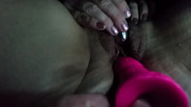 Wife with toy on her clit, vibrator in her ass, and me fucking her with a dildo