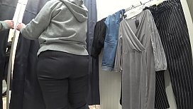 A plump milf with a juicy ass in white panties and big tits in a bra got into the lens of a hidden camera in a public dressing room.