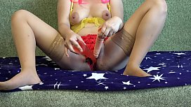 Pregnant milf in sexy outfit with two dildos fucks her hairy pussy through thong.