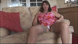 Busty mature brunette with...
