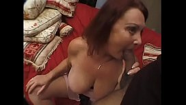 Mature redhead Gigi with huge boobs sucks and fucks stud'_s dick in bed
