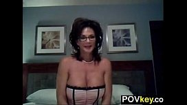 Busty MILF Strips And...