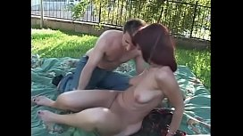 Redhead MILF Rubee Tuesday is fucked outdoors by a stud then gets facial