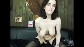 Busty brunette toys her hairy pussy on cam