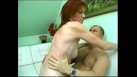 Redhead immerses herself in a powerful blowjob