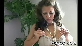 Tempting playgirl popping balloons with her cigarette