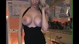 Busty blonde babe plays with her dildo