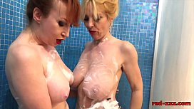 Mature redhead plays in the shower with her girlfriend