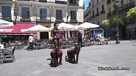 Female slaves made to crawl in public